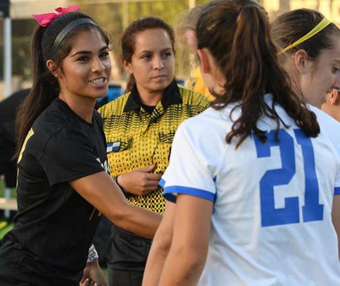 Ashley Gonzales shakes hands with UCLA players before suffering a suspected knee injury 12 minutes in
