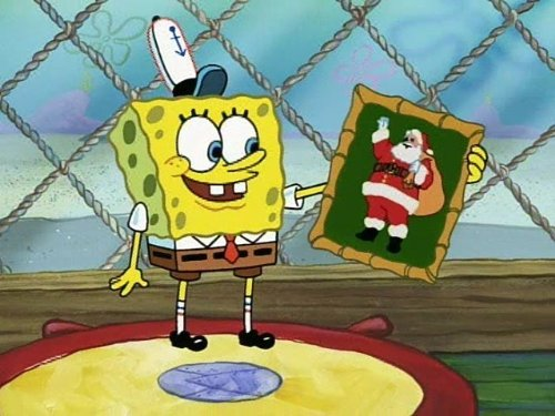 Spongebob Squarepants holding up a picture of Santa